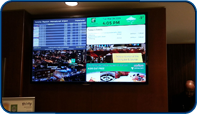 60 inch flat panel installed by Saturn Digital Media at the Holiday Inn Toronto Downtown Centre that displays current hotel events, advertising, corporate video and current flight departure information from Toronto Pearson International.