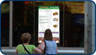 Digital Menu Screen installed at in window of Carlton Restaurant in Toronto, Ontario by Saturn Digital Media